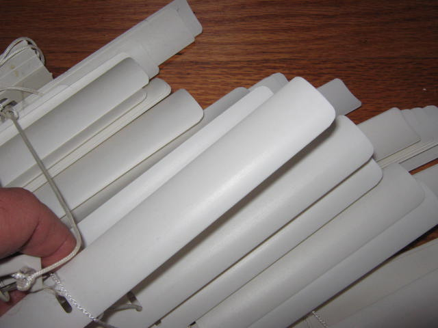One set of broken window blinds will provide materials for years worth of plant tags.