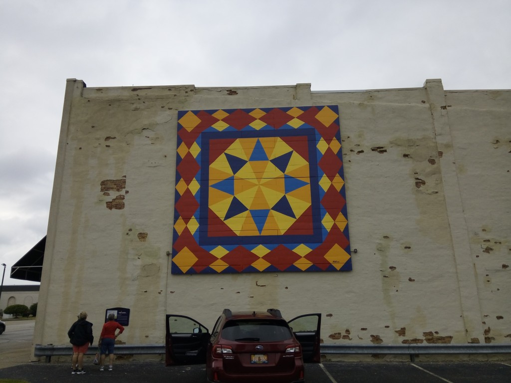 This large quilt mural dresses up an otherwise drab wall.